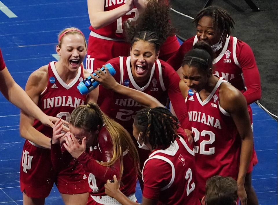 Indiana  guard Nicole Cardano-Hillary (4) is doused by her teammates as they celebrate defeating NC State in the Sweet 16.