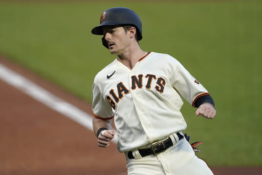 San Francisco Giants' Mike Yastrzemski scores against the Seattle Mariners during the first inning of a baseball game in San Francisco, Wednesday, Sept. 16, 2020. (AP Photo/Jeff Chiu)