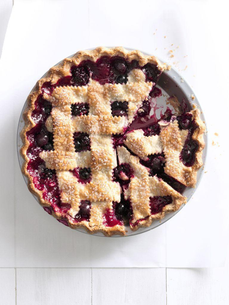 """<p>Strawberries, cherries, blueberries, blackberries, and raspberries come together in this ultimate summer dessert. </p><p><em>Get the recipe from <a href=""""https://www.countryliving.com/food-drinks/recipes/a5531/cherry-berry-jumble-fruit-pie-recipe-clx0914-1/"""" rel=""""nofollow noopener"""" target=""""_blank"""" data-ylk=""""slk:Country Living"""" class=""""link rapid-noclick-resp"""">Country Living</a>.</em></p>"""
