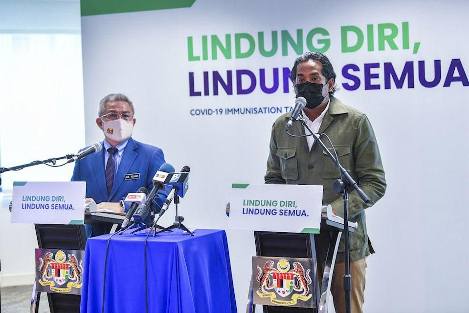 Coordinating Minister for National Covid-19 Immunisation Programme Khairy Jamaluddin (right) at a press conference in Putrajaya, April 12, 2021 with Health Minister Datuk Seri Dr Adham Baba on the latest development of the National Covid-19 immunisation Programme. — Bernama pic