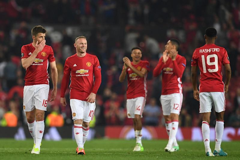 (L-R) Manchester United celebrate winning their UEFA Europa League semi-final, second-leg football match against Celta Vigo at Old Trafford stadium in Manchester, north-west England, on May 11, 2017