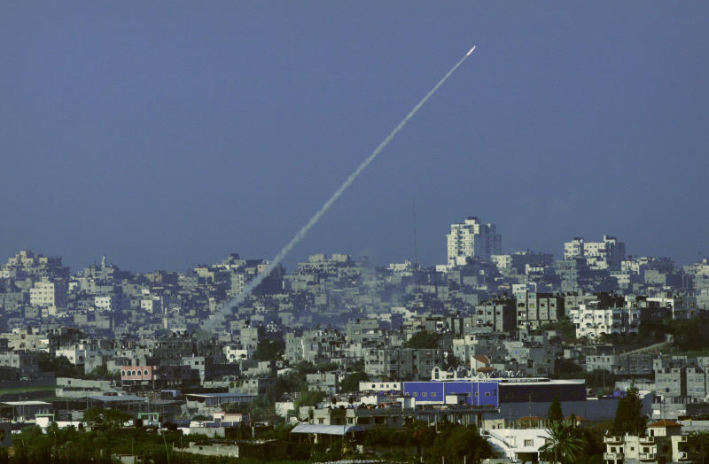 FILE - In this Jan 7, 2009, file photo, a rocket fired by Palestinian militants in the Gaza Strip is seen from southern Israel, near Israel's border with the Gaza Strip. Over the years, the Islamic militant Hamas group has built up a large arsenal of rockets and missiles that have evolved from rudimentary short-range projectiles into powerful weapons capable of striking virtually anywhere in Israel. (AP Photo/Dan Balilty, File)