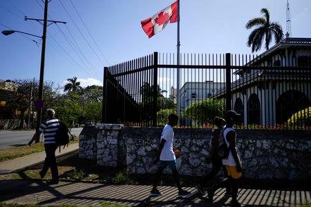 FILE PHOTO: People pass by the Canada's Embassy in Havana