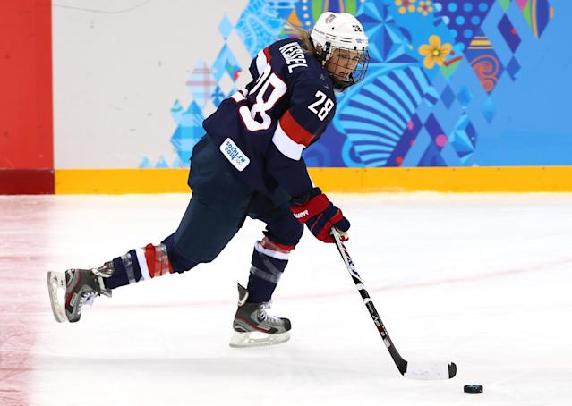 SOCHI, RUSSIA - FEBRUARY 08: Amanda Kessel #28 of United States skates with the puck against Finland during the Women's Ice Hockey Preliminary Round Group A Game on day 1 of the Sochi 2014 Winter Olympics at Shayba Arena on February 8, 2014 in Sochi, Russia. (Photo by Martin Rose/Getty Images)