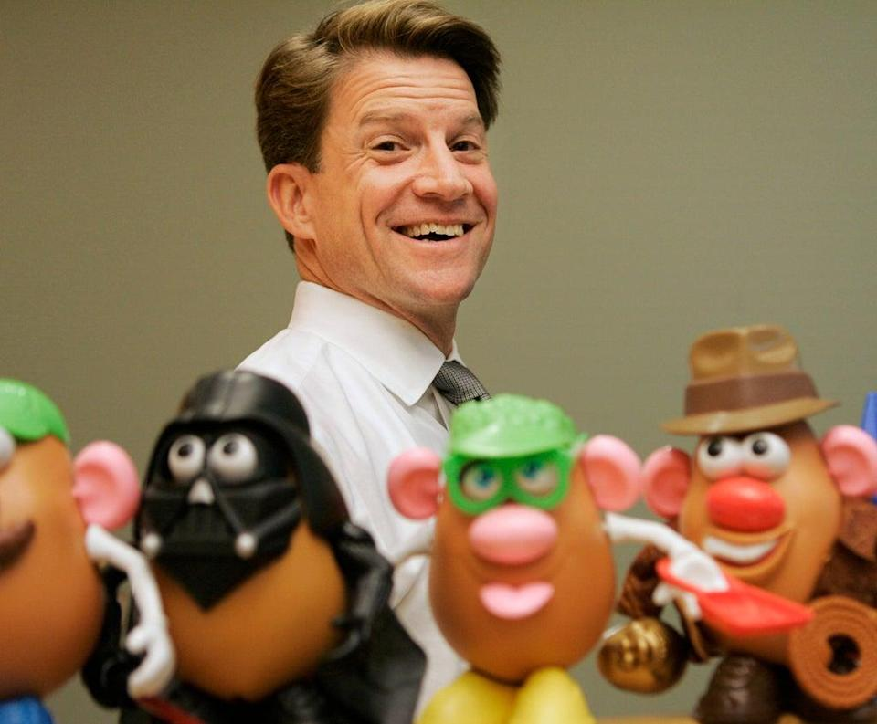 In this 2008 file photo, Brian Goldner stands next to some toy figures at Hasbro's headquarters, in Pawtucket, Rhode Island  (AP)
