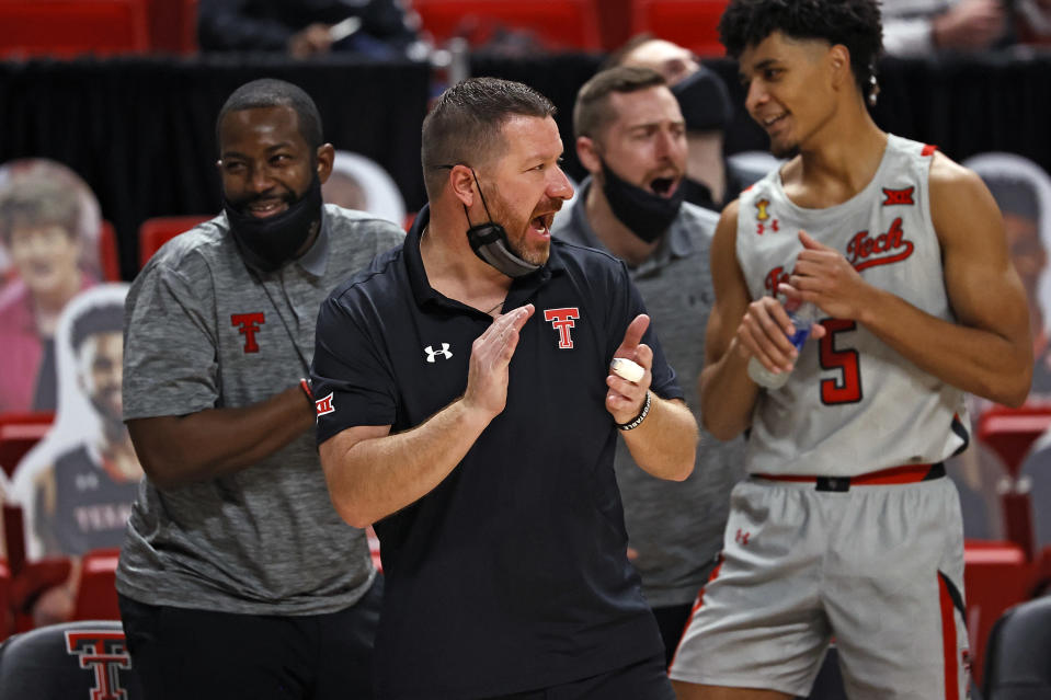 Texas Tech coach Chris Beard claps for the team during the second half of an NCAA college basketball game against Troy, Friday, Dec. 4, 2020, in Lubbock, Texas. (AP Photo/Brad Tollefson)