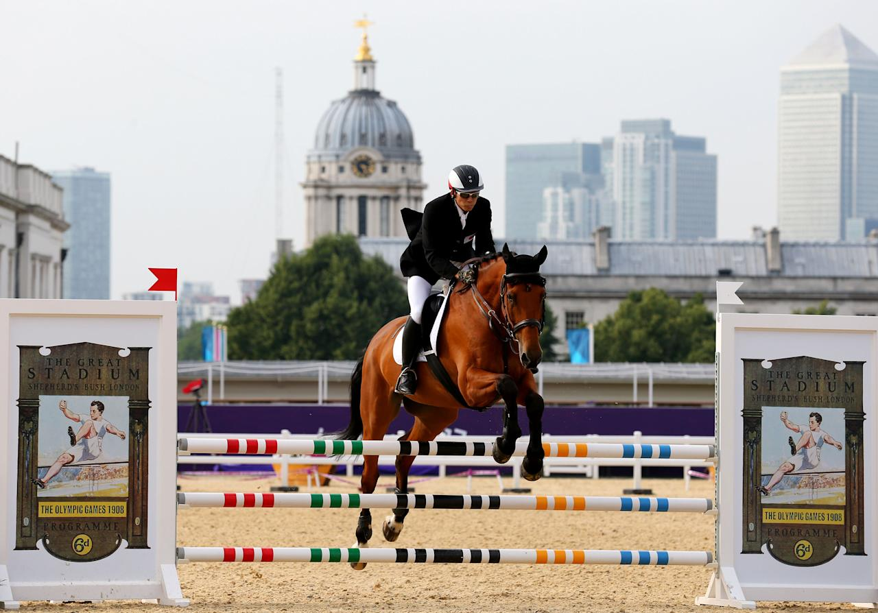 LONDON, ENGLAND - AUGUST 11:  Shinichi Tomii of Japan riding Loughnatousa Romeo competes in the Riding Show Jumping during the Men's Modern Pentathlon on Day 15 of the London 2012 Olympic Games on August 11, 2012 in London, England.  (Photo by Alex Livesey/Getty Images)