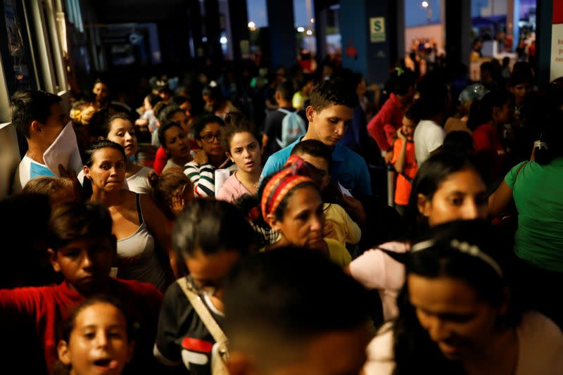 FILE PHOTO: Venezuelans at the Ecuadorian Peruvian border service center in the outskirts of Tumbes