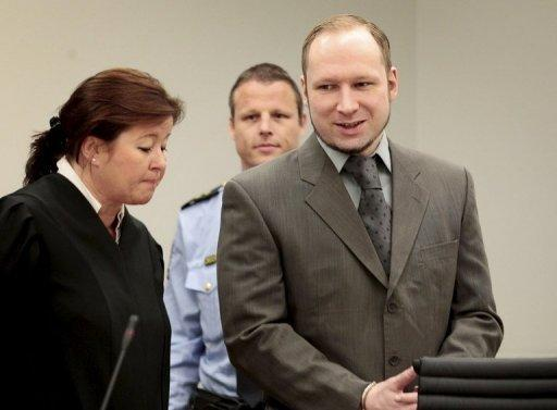 Norwegian killer Anders Behring Breivik arrives in court in Oslo with his lawyer Vibeke Hein Baera on April 25. A brother of one of Breivik's victims threw a shoe at him Friday, which missed the defendent but hit Hein Baera
