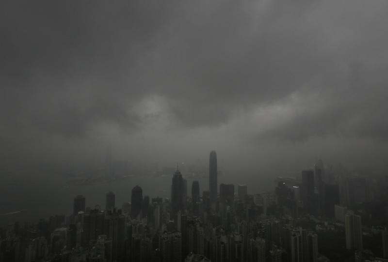 Dark clouds hang low over Hong Kong's Victoria Habour Sunday, Sept. 22, 2013. Usagi, the year's most powerful typhoon had Hong Kong in its cross-hair on Sunday after sweeping past the Philippines and Taiwan and pummeling island communities with heavy rains and fierce winds. The typhoon was grinding westward and expected to make landfall close to Hong Kong late Sunday or early Monday. (AP Photo/Vincent Yu)