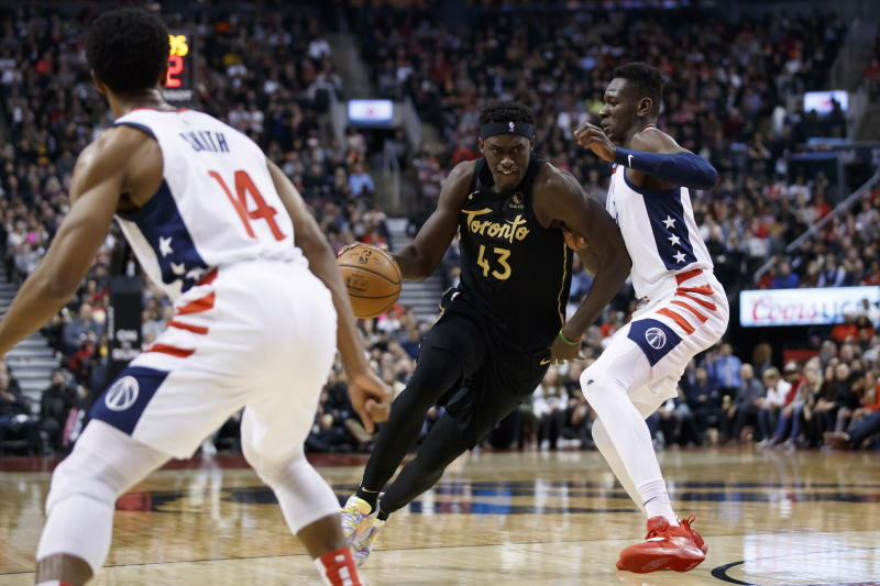 CORRECTS PLAYER AT RIGHT TO ISAAC BONGA, INSTEAD OF THOMAS BRYANT - Toronto Raptors forward Pascal Siakam (43) drives against Washington Wizards center Isaac Bonga, right, during the first half of an NBA basketball game Friday, Jan. 17, 2020, in Toronto. (Cole Burston/The Canadian Press via AP)