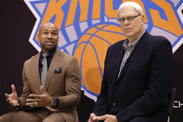 While New York Knicks president Phil Jackson, right, listens, Derek Fisher speaks during a news conference in Tarrytown, N.Y., Tuesday, June 10, 2014. The New York Knicks hired Fisher as their new coach on Tuesday, with Jackson turning to one of his trustiest former players