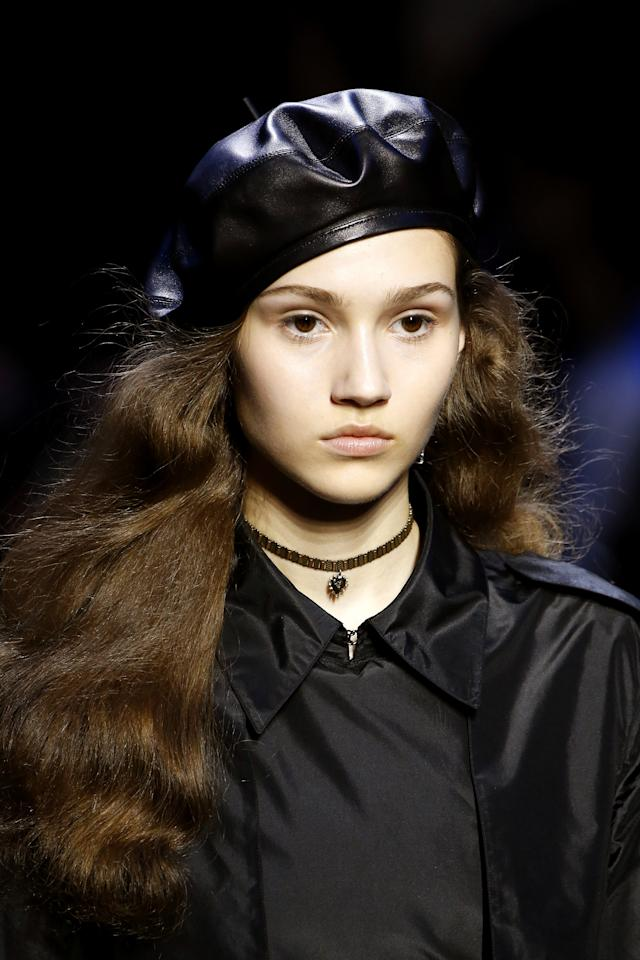 <p>At Christian Dior's Fall 2017 fashion show, models with voluminous, brushed out curls walked the runway wearing black berets.</p>
