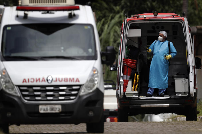 A healthcare worker disinfects an ambulance used to transport a patient suspected of having COVID-19, at the HRAN public hospital in Brasilia, Brazil, Tuesday, March 23, 2021. Hundreds of Brazilian economists, including former finance ministers and central bank presidents, urged the Brazilian government in an open letter published on Monday to speed up vaccination and adopt tougher restrictions to stop the rampant spread of the new coronavirus. (AP Photo/Eraldo Peres)