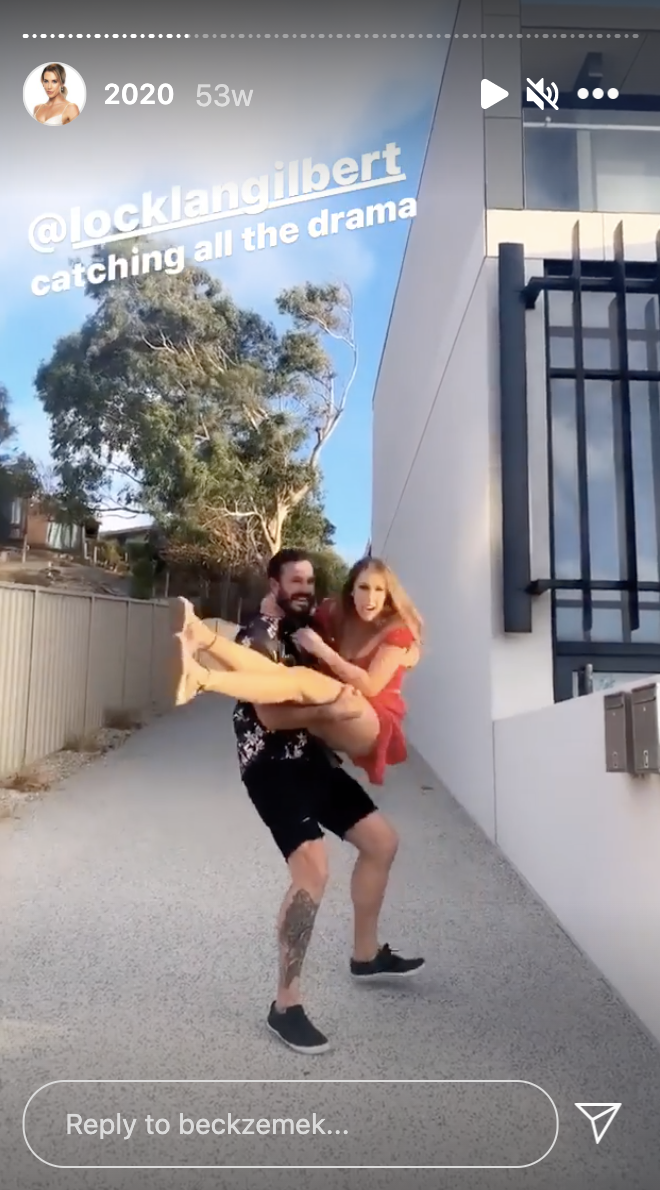 The Bachelor contestant Locky Gilbert holding Married At First Sight 2021 contestant Bec Zemek in a firemans hold