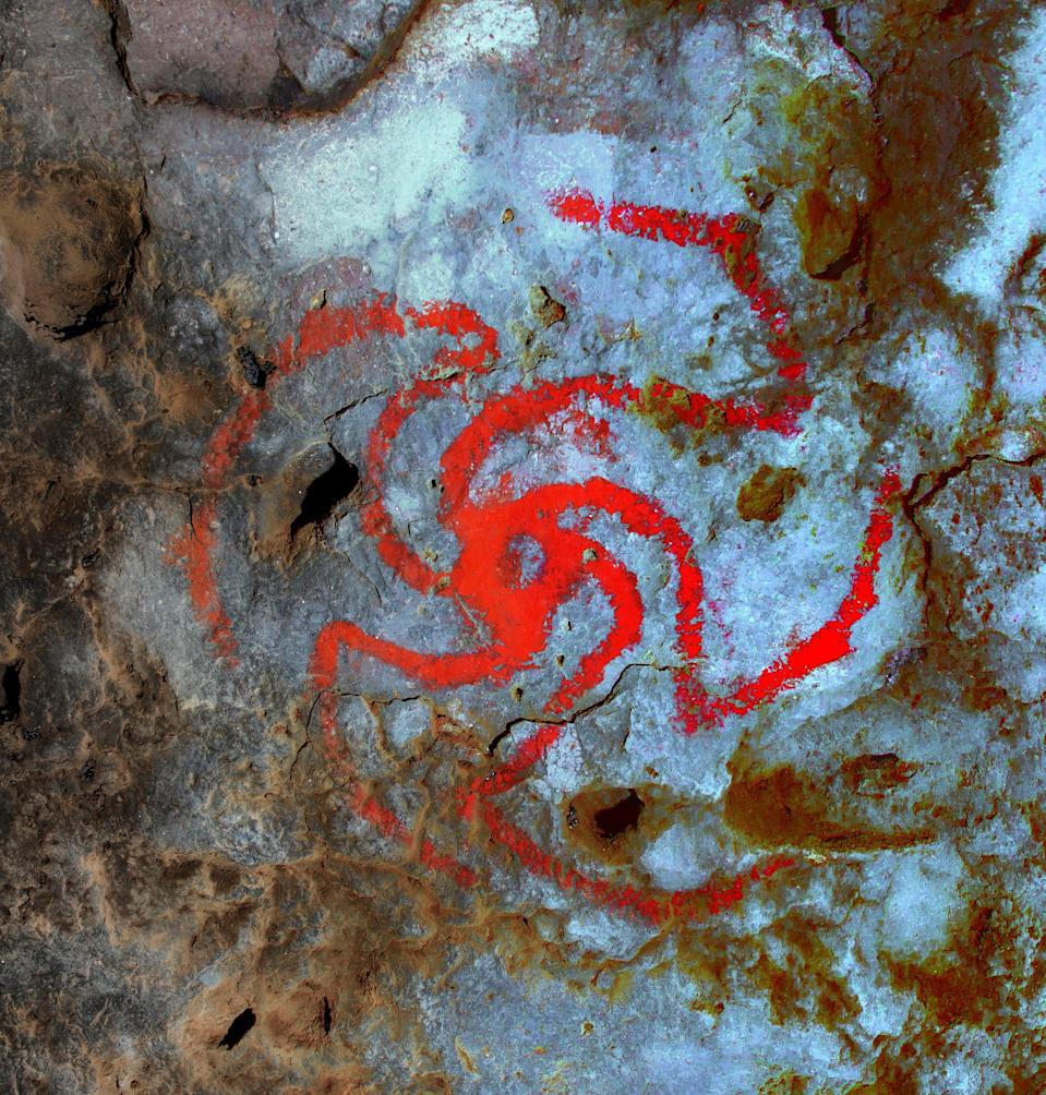 A digitally enhanced image of a pinwheel painting in Pinwheel Cave, Calif. For the first time, a study finds evidence suggesting that a hallucinogenic plant was consumed at a rock art site and that the art is likely a representation of the plant.