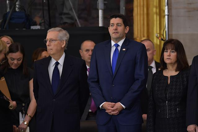 <p>Senate Majority Leader Mitch McConnell (R-Ky.), Left, and House Speaker Paul Ryan (R-WI) attend the memorial service for Reverend Billy Graham in the Rotunda of the US Capitol on Feb. 28, 2018 in Washington. (Photo: Mandel Ngan/AFP/Getty Images) </p>