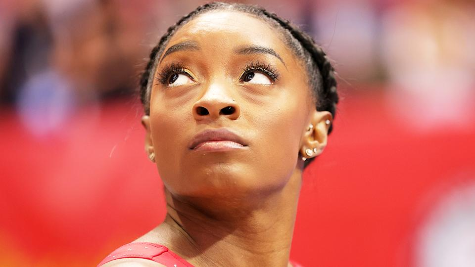 Simone Biles (pictured) looking up before the US Women's Gymnastics Olympic trials.