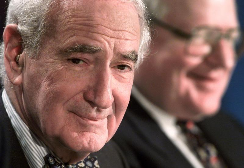Comcast Chairman Ralph Roberts (L) ponders a reporters question as MediaOne Chairman and Chief Exec..