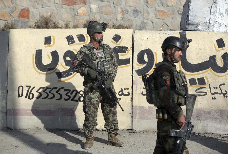 National army soldiers stand guard in front of the Kabul Military Training Center in Kabul, Afghanistan, Monday, Nov. 18, 2019. Back-to-back explosions early Monday targeting the military training center wounded Afghan national army soldiers, police and interior spokesmen said. (AP Photo/Rahmat Gul)