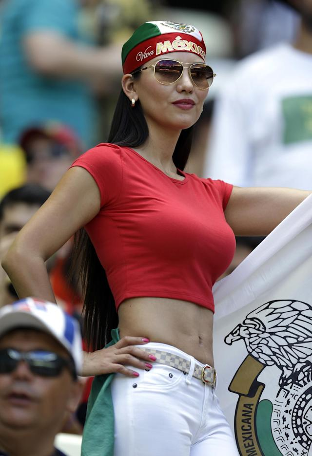 A Mexico supporter waits for the start of the World Cup round of 16 soccer match between the Netherlands and Mexico at the Arena Castelao in Fortaleza, Brazil, Sunday, June 29, 2014. (AP Photo/Natacha Pisarenko)