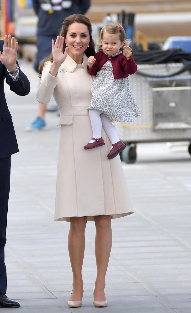 October in Victoria, British Columbia, can be a bit chilly, and young Princess Charlotte demonstrated that she knows the art of layering. Trading white ankle socks for warmer tights, the little Princess paired a burgundy cardigan over a floral printed dress (a signature of hers!) with of course, matching Mary-Janes.