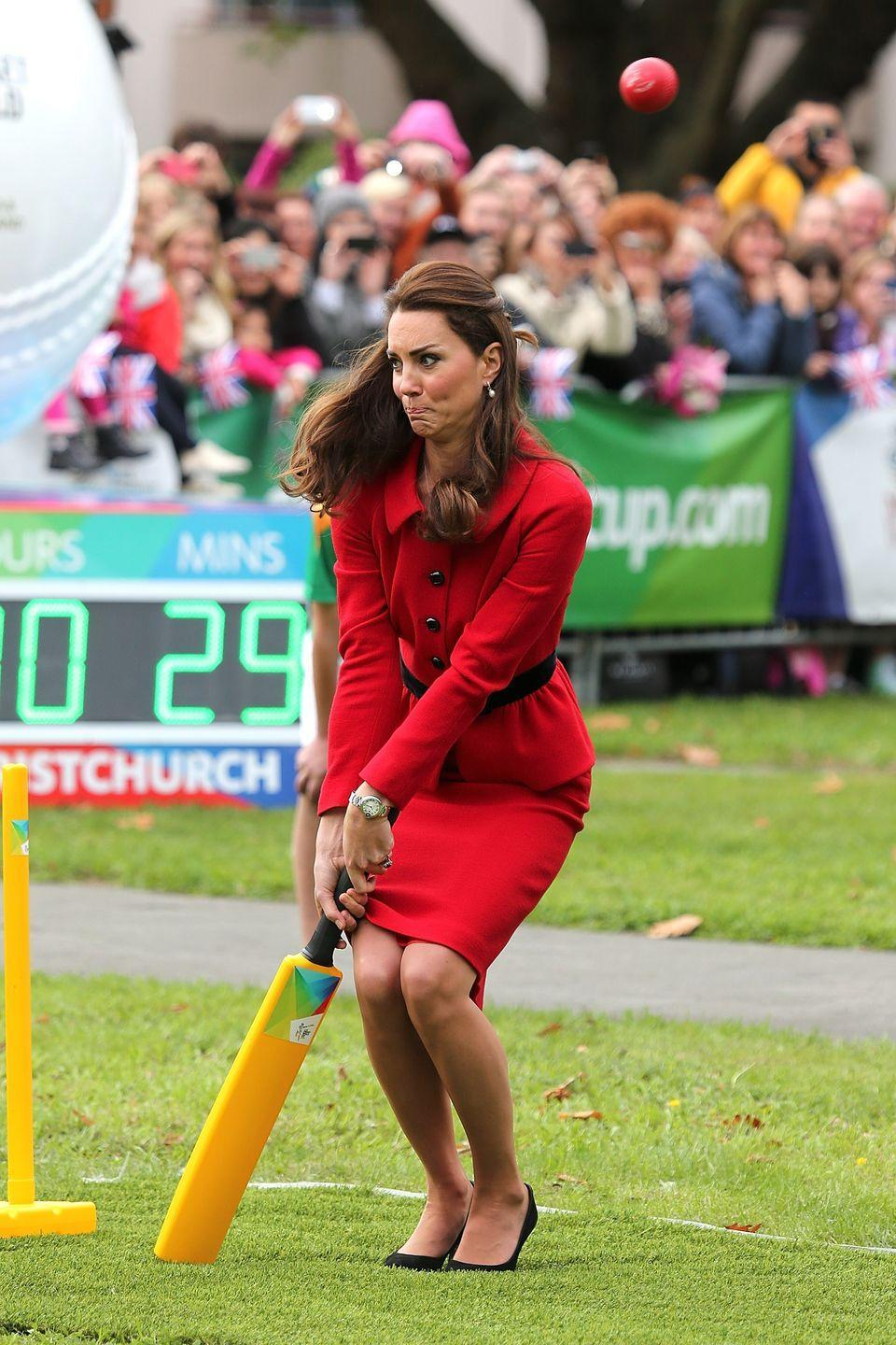 <p>Yet another example of Kate's competitive side came out while on a royal tour of New Zealand and Australia. For fun, she decided to take Will on in a game of cricket ... in a stunning red coat and dress, nonetheless. After all, she is a Duchess.</p>