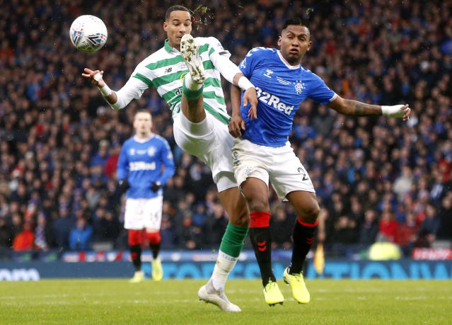 Celtic's Christopher Jullien, left, and Rangers' Alfredo Morelos battle for the ball during their Scottish Cup Final at Hampden Park, Glasgow, Scotland, Sunday, Dec. 8, 2019. (Jeff Holmes/PA via AP)