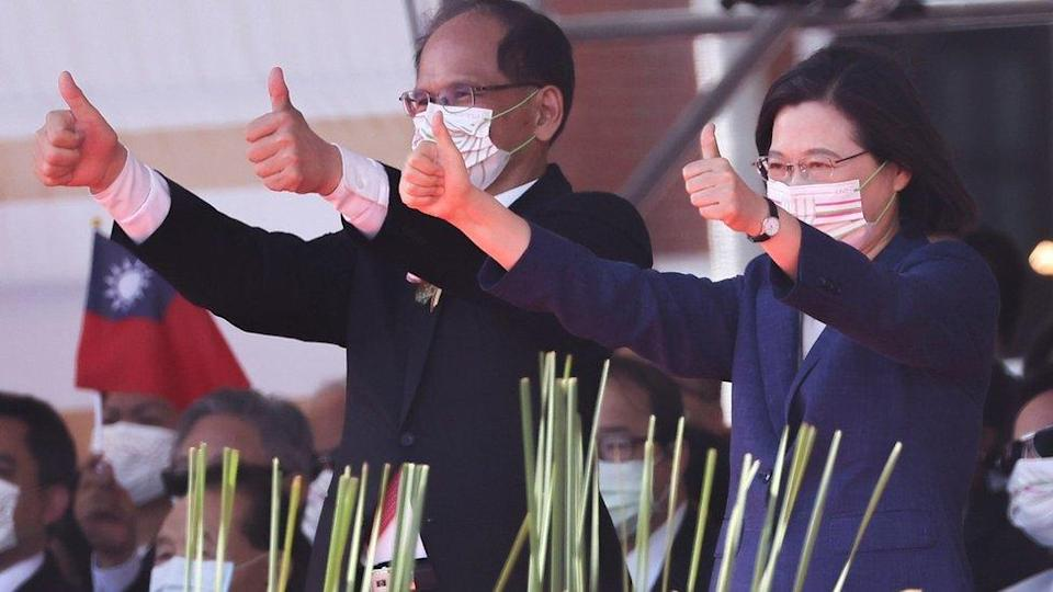 """Taiwan""""s President Tsai Ing-wen gives a thumbs up during the national day celebration in Taipei, Taiwan, October 10,2021"""