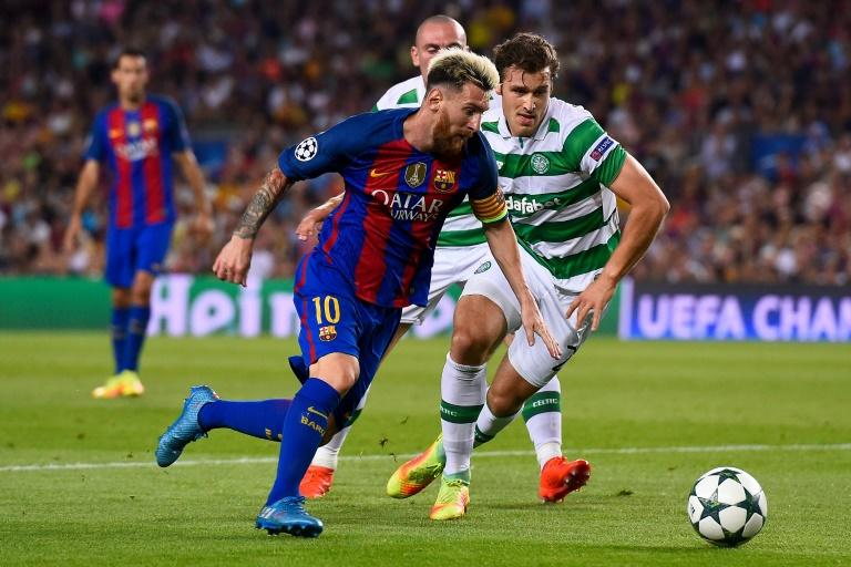 Barcelona's Argentinian forward Lionel Messi (L) vies with Celtic's Danish defender Erik Sviatchenko during the UEFA Champions League football match FC Barcelona vs Celtic FC at the Camp Nou stadium in Barcelona on September 13, 2016