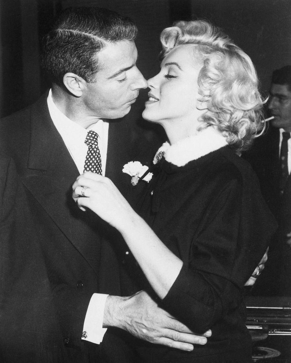 """<p>After a simple courthouse ceremony, Joe DiMaggio sealed his nuptials to Marilyn Monroe with a diamond eternity band. The engagement ring, <a href=""""https://theadventurine.com/bridal/engagement-rings/the-mystery-of-marilyn-monroes-eternity-band-from-joe-dimaggio/"""" rel=""""nofollow noopener"""" target=""""_blank"""" data-ylk=""""slk:set in platinum"""" class=""""link rapid-noclick-resp"""">set in platinum</a> and fitted with 36 baguette cut diamonds, was a huge trendsetter. </p>"""