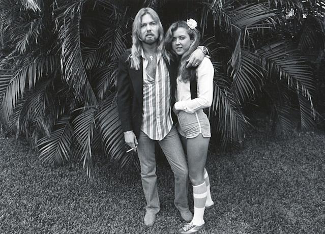 <p>Gregg Allman and his bride, Julie Bidas, as they pose in the back yard of the Palm Beach Institute, West Palm Beach, Florida, 1979. The couple married in November, but divorced in 1981. (Patrick Partington/Getty Images) </p>
