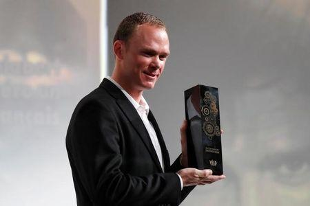 Tour de France 2017 winner Chris Froome of Britain poses with the Golden bike trophy he received during the presentation of the itinerary of the 2018 Tour de France cycling race in Paris, France, October 17, 2017. REUTERS/Charles Platiau