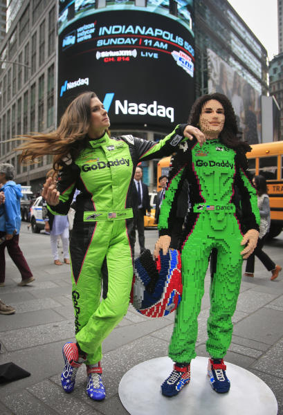 Race driver Danica Patrick, left, pose with a life-size Lego statue creation of herself, Tuesday, May 22, 2018, in New York. Lego master builder Chris Steininger says it took him 200 hours to build, using under 15,000 pieces and 13 different colors. (AP Photo/Bebeto Matthews)