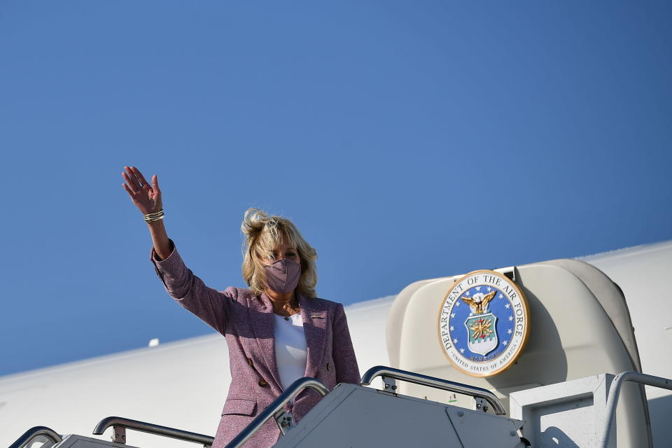 First lady Jill Biden waves as she arrives at Erie International Airport in Erie, Pa., Wednesday, March 3, 2021. (Mandel Ngan/Pool via AP)