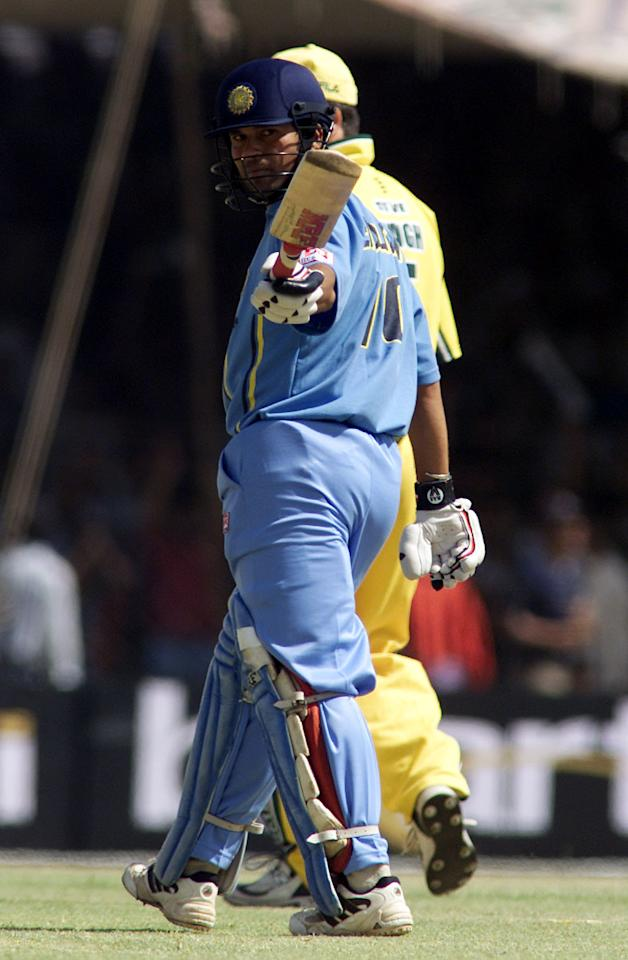 31 Mar 2001:  Sachin Tendulkar of India acknowledges the crowd after becoming the first player to score 10,000 runs in one day cricket, during the 3rd One Day International between India and Australia, played at Nehru Stadium, Indore, India.  X DIGITAL IMAGE Mandatory Credit: Hamish Blair/ALLSPORT