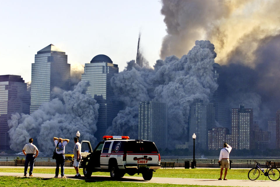 <p>The remaining tower of New York's World Trade Center, Tower 2, dissolves in a cloud of dust and debris about a half hour after the first twin tower collapsed. (Reuters)</p>