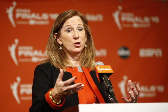 FILE - In this Sept. 29, 2019, file photo, WNBA Commissioner Cathy Engelbert speaks at a news conference before Game 1 of basketball's WNBA Finals between the Connecticut Sun and the Washington Mystics, in Washington. The WNBA draft will be a virtual event this year. The league announced Thursday, March 26, 2020, that its draft will still be held April 17 as originally scheduled, but without players, fans or media in attendance due to the coronavirus pandemic. The WNBA draft is a time to celebrate the exceptional athletes whose hard work and dreams are realized with their selections in the draft, WNBA Commissioner Cathy Engelbert said. (AP Photo/Patrick Semansky, File)