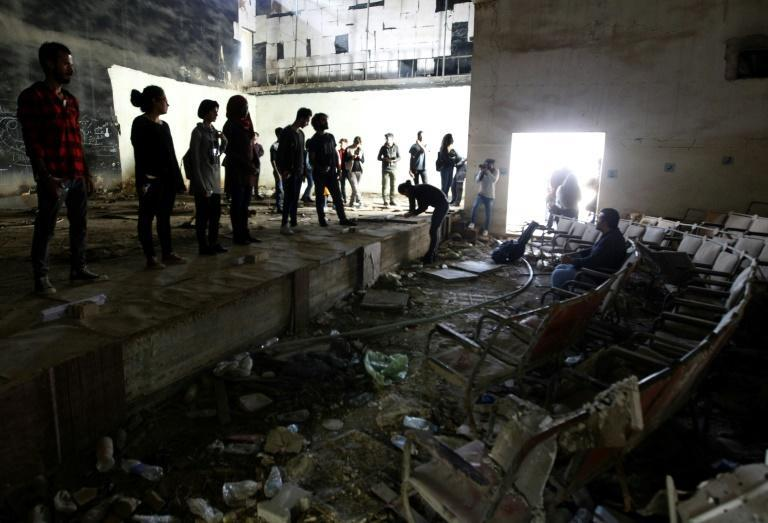 Artists practise at the Abu Nuwas Theatre that was destroyed in 2003 during the war in the Iraqi capital Baghdad on November 17, 2018
