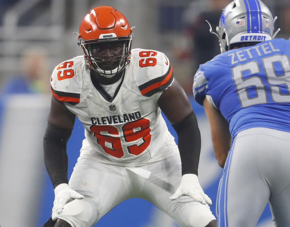 FILE - In this Aug. 30, 2018, file photo, Cleveland Browns offensive tackle Desmond Harrison (69) defends the line as Detroit Lions defensive end Anthony Zettel (69) rushes during the first half of an NFL football preseason game, in Detroit. The Browns could be shaking up their offensive line again. With the season opener against Pittsburgh just a week away, coach Hue Jackson said Friday, Aug. 31, 2018, that all avenues are open with his offensive line, which has been in flux since 10-time Pro Bowl tackle Joe Thomas retired after last season. Jackson reiterated he wants the best five guys out there and he said undrafted rookie Desmond Harrison could be in the mix. (AP Photo/Paul Sancya, File)