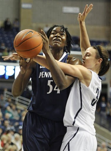 Penn State's Nikki Greene, left, is guarded by Connecticut's Kelly Faris, right, during the first half of an NCAA college basketball game in Storrs, Conn., Thursday, Dec. 6, 2012. (AP Photo/Jessica Hill)