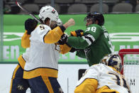 Nashville Predators defenseman Matt Benning (5) takes a punch from Dallas Stars center Joel L'Esperance (38) during a fight in the second period of an NHL hockey game on Sunday, March 7, 2021, in Dallas. (AP Photo/Richard W. Rodriguez)