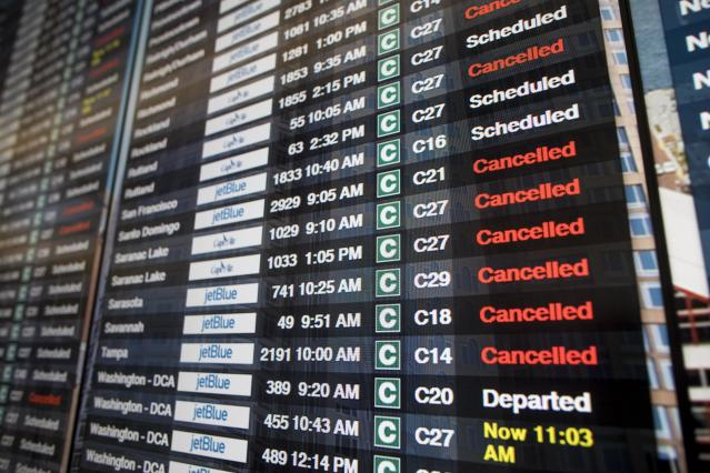 Board shows many flight cancellations and delays following a 'bomb cyclone' in Boston, Massachusetts.