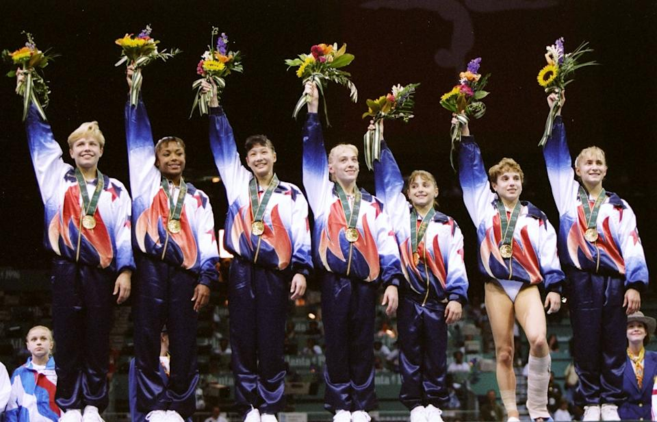 23 Jul 1996: General view of the United States women''s gymnastics team after winning the gold medal in team optionals at the Summer Olympics in the Georgia Dome in Atlanta, Georgia. Mandatory Credit: Doug Pensinger /Allsport