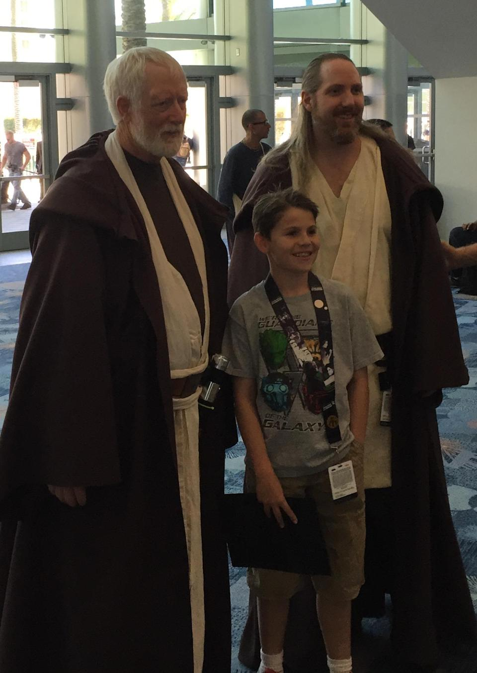 These Jedi Masters are always ready for a photo opp with a potential Padawan.