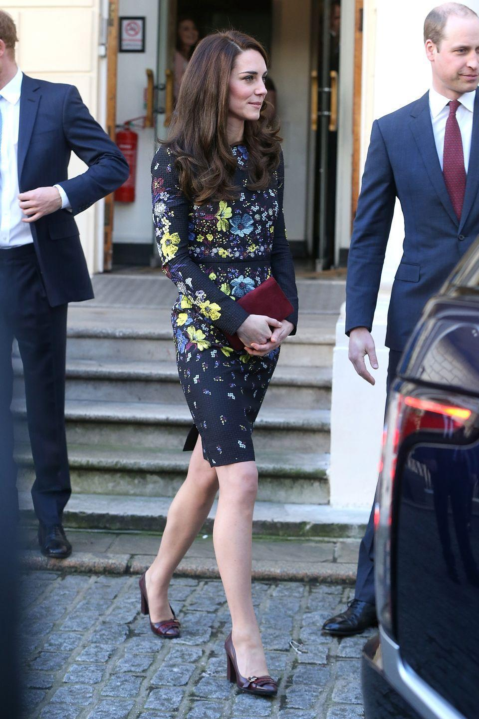 <p>Middleton wears a navy floral dress by Erdem, oxblood pumps and a deep red suede clutch in London, where she, Prince William and Prince harry spoke about their work with the Heads Together organization.</p>