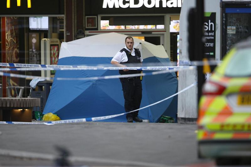Knife attack: A forensic tent is erected outside McDonald's near Stratford Broadway following the fatal stabbing: PA