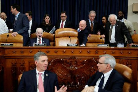 Members including Rep. Kevin Brady (R-TX), center, arrive for a House Ways and Means Committee markup of the Republican Tax Reform legislation on Capitol Hill in Washington, U.S., November 9, 2017. REUTERS/Aaron P. Bernstein