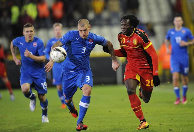 Slovakia's Martin Skrtel (2ndL) and Belgium's Romelu Lukaku (R) vie for the ball during their friendly football match in Bruges on February 6, 2013. AFP PHOTO / JOHN THYSJOHN THYS/AFP/Getty Images