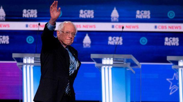 PHOTO: Democratic presidential hopeful Sen. Bernie Sanders waves ahead of the tenth Democratic primary debate of the 2020 presidential campaign season at the Gaillard Center in Charleston, S.C., on Feb. 25, 2020. (Jim Watson/AFP via Getty Images)